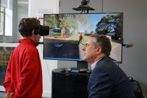 Graduate Tyler using VR experience with Jim Hungerford