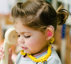 Little girl with hearing loss plays at The Shepherd Centre